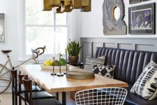 10 a modern dining area with a black leather banquette and a raw edge dining table