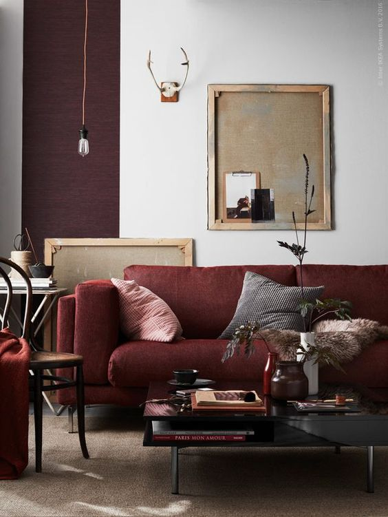 a moody living room with shades of plum and burgundy for a bold and creative look