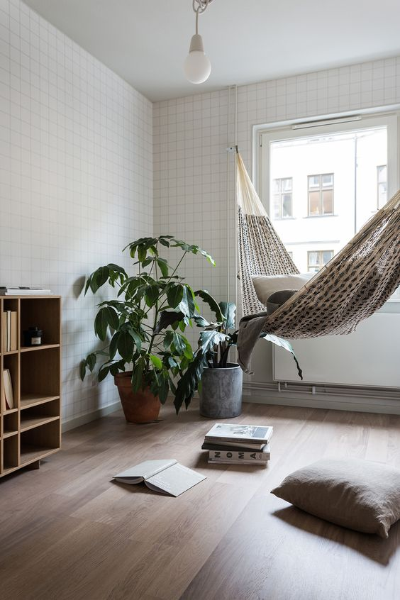 a serene contemporary space is softened and made more relaxed with a hammock