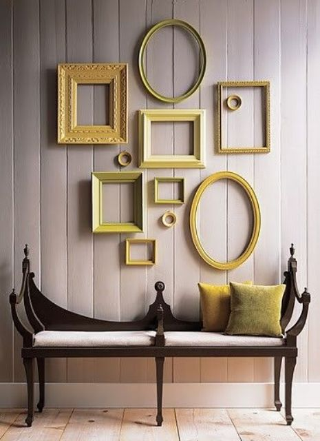 add a touch of color with a gallery wall in the shades of yellow and green and matching pillows