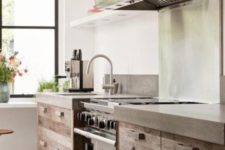 10 an industrial space of rough wood, stainless steel and concrete countertops for a tough look