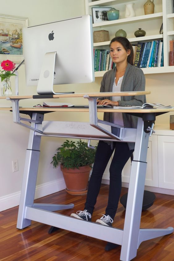 a large standing desk and a leaning stool will take some space but will make you fele comfortable