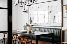 11 a mid-century modern space with a green leather banquette seating and a black table