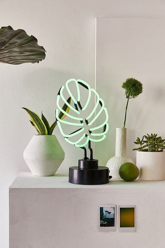 a monstera leaf neon tale lamp won't wither and will spruce up your space making it whimsy and cool