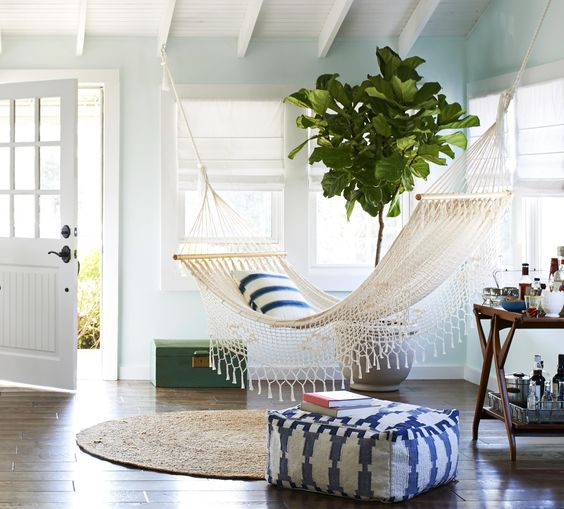 a welcoming space with a hammock and a home bar   what else do we need for a good day