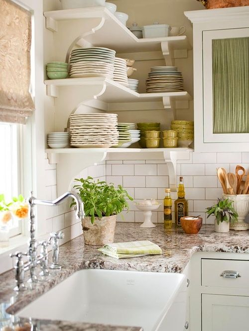 a white rustic kitchen with brown granite countertops and a tile backsplash for a chic look