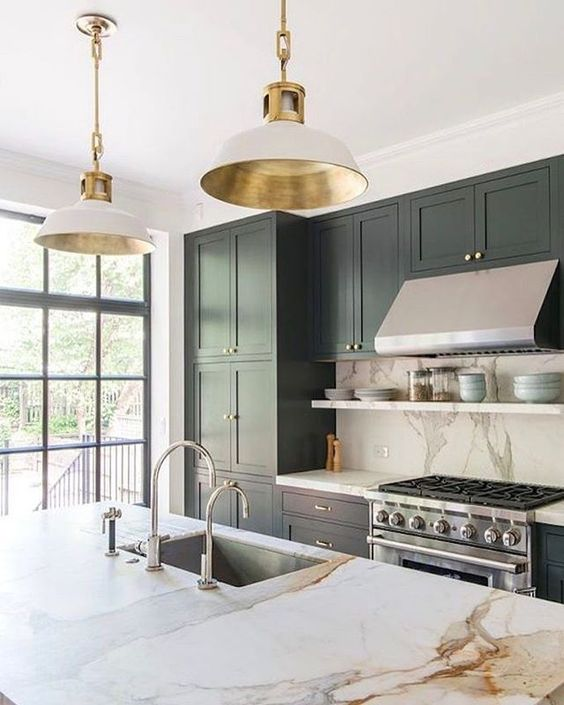 stainless steel of the appliances is the main here, and shiny gold adds to the space