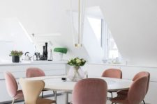13 a contemporary dining space with dusty rose chairs for a colorful touch in the neutral space