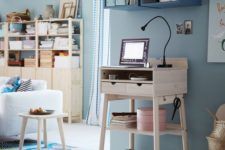13 a little light-colored wooden standing desk won't take much space and is suitable for tiny spaces