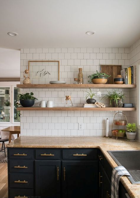 black cabinets, light-colored wooden shelves and brown countertops make up a chic kitchen