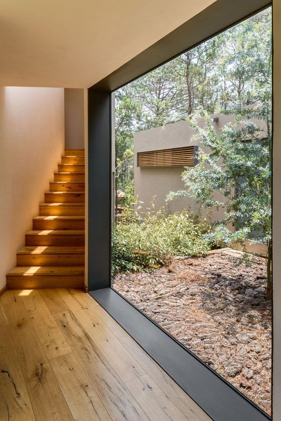 invite outside inside with such a gorgeous modern floor to ceiling window with no blocks for the view