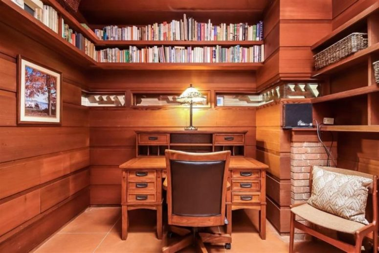 There's also a home office with lots of bookshelves going along the whole perimeter of the room