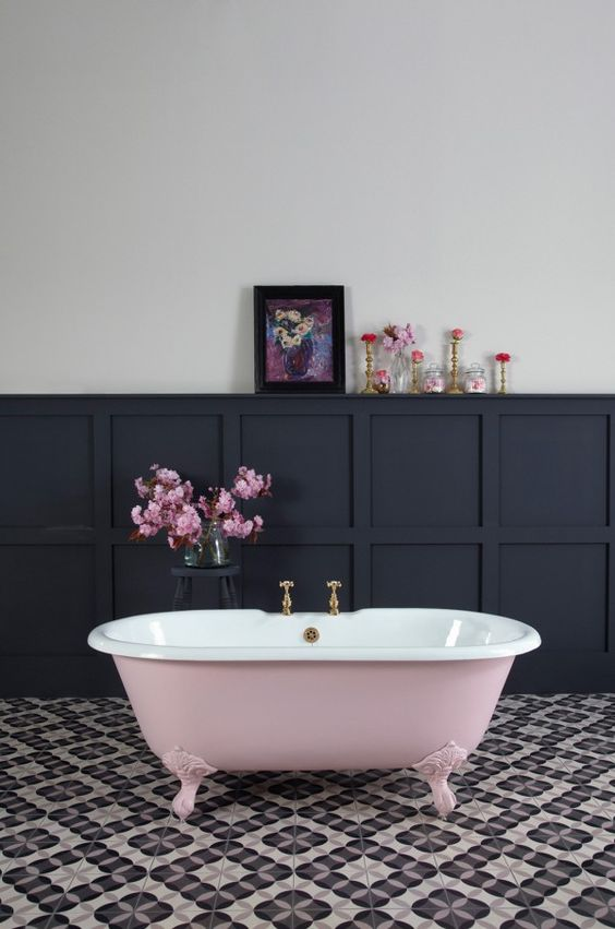 a dusty rose bathtub in a monochromatic space adds a soft girlish feel