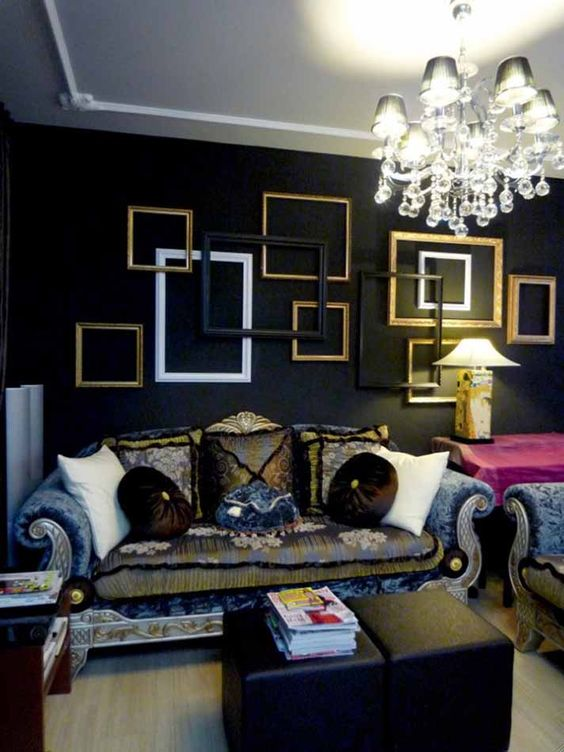 a moody refined space highlighted with an arrangement of frames in black, white and gold