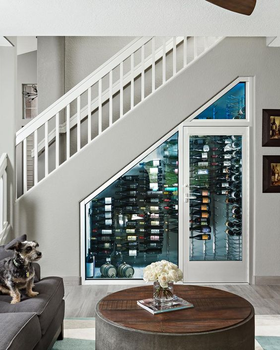 a tiny wine cellar with wall shelves to store wine bottles and even some of them on the floor