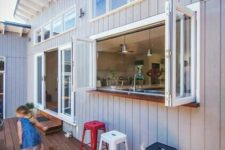 14 an outdoor bar with a bifold window to the kitchen is a cool space-saving idea