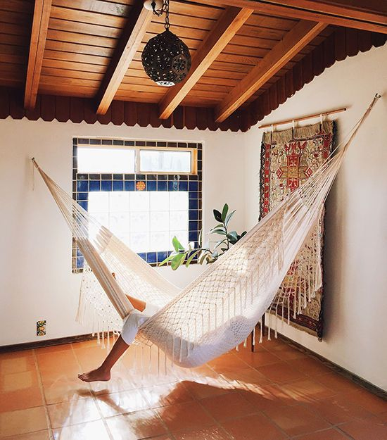 hanging a hammock in any indoor space instantly brings relaxed vibes there