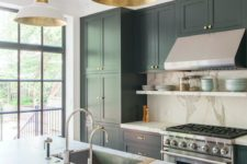 15 a chic art-deco inspired kitchen with black cabinets, touches of gold and marble-style granite countertops