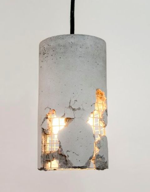 a cracking concrete pendant lamp is an amazing idea to give an industrial look to the space