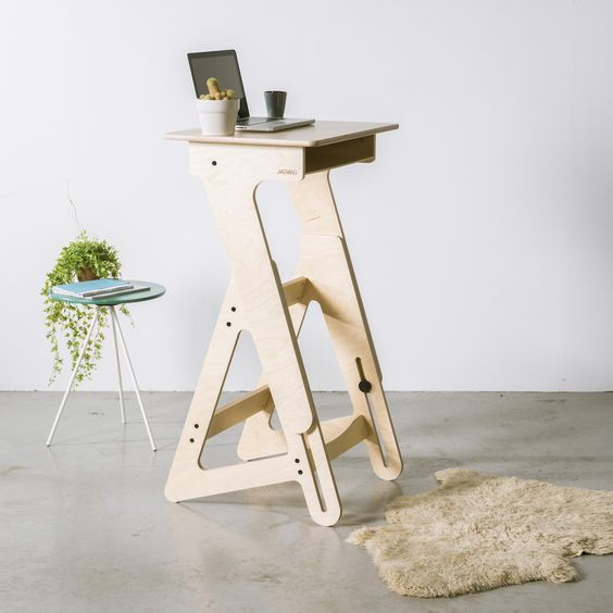 a small modern stand desk of high quality wood is a chic idea for a tiny space and looks stylish