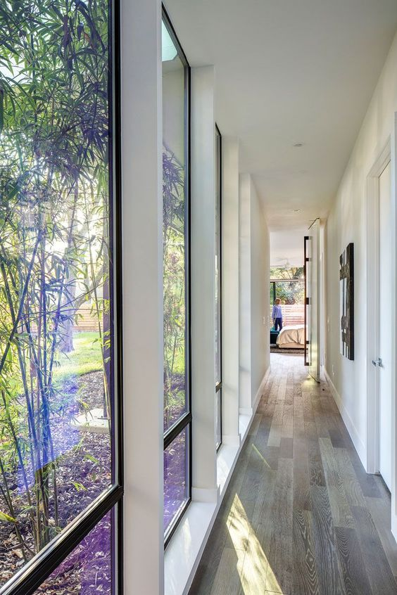 illuminate your corridor with several floor to ceiling windows to make it visually larger