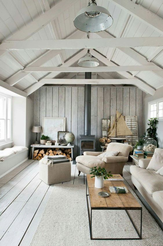 refreshing coastal  room is done with a grey plank wall and floor for a washed out coastal feel