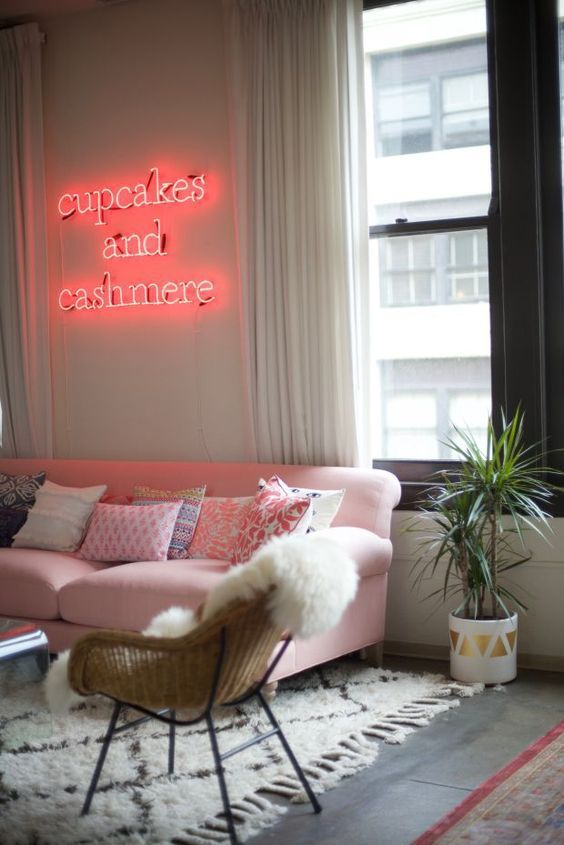 spruce up your girlish living room with a proper pink neon light over the sofa, so whimsy and glam
