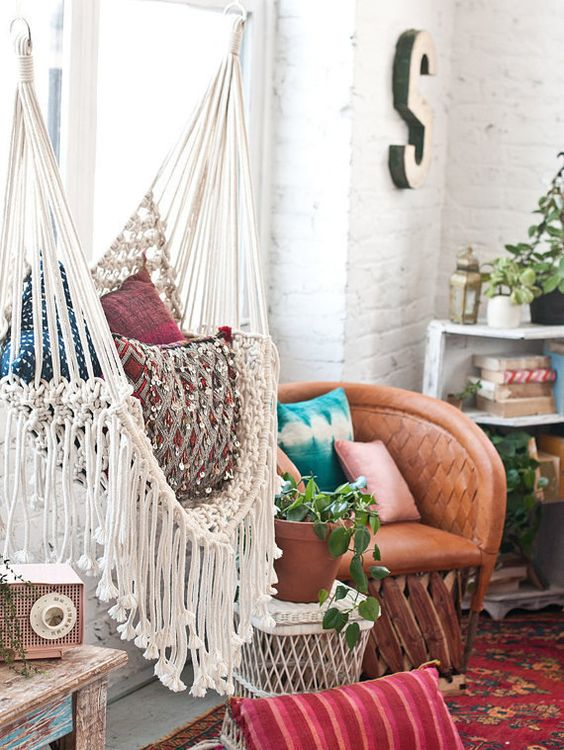 a boho space really requires a fringed hammock chair to complete it and bring an even more relaxed feel