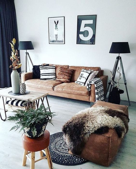 a brown leather ottoman of a large size and a matching sofa make the space cool