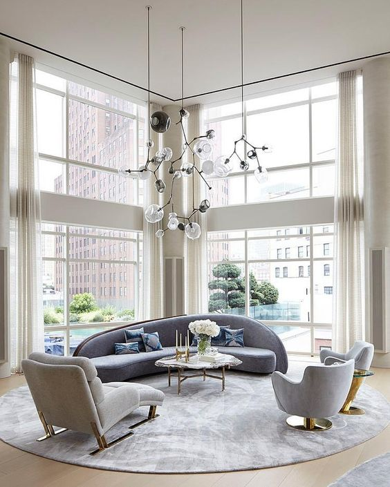 a couple of floor to ceiling windows fill the space with light and helps to highlight the double height of the ceiling