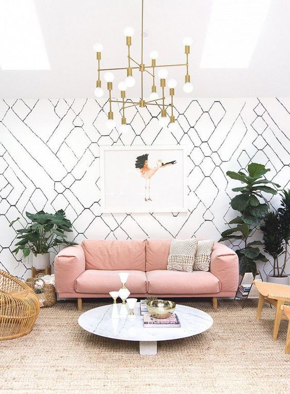 a mid-century modern living room with a dusty rose sofa for a soft colorful touch