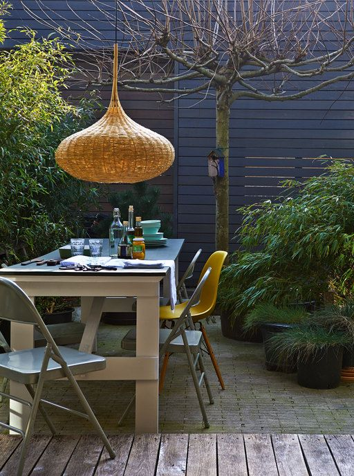 a modern dining space is made cooler and cozier with a catchy wicker lampshade