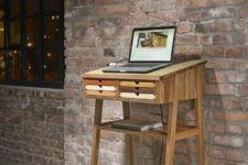 16 a small wooden standing desk with little colorful drawers is suitable for a laptop
