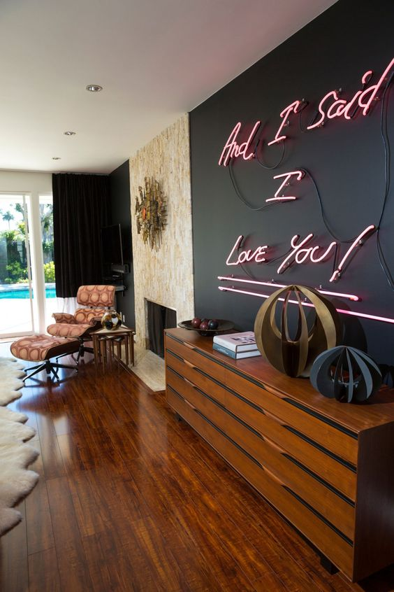 add romance to your living room with a whole wall done with neon lights and your space will shine