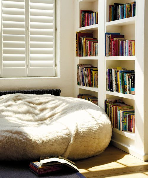 spruce up a reading nook with a large furry bean bag chair and make the space more informal and comfortable