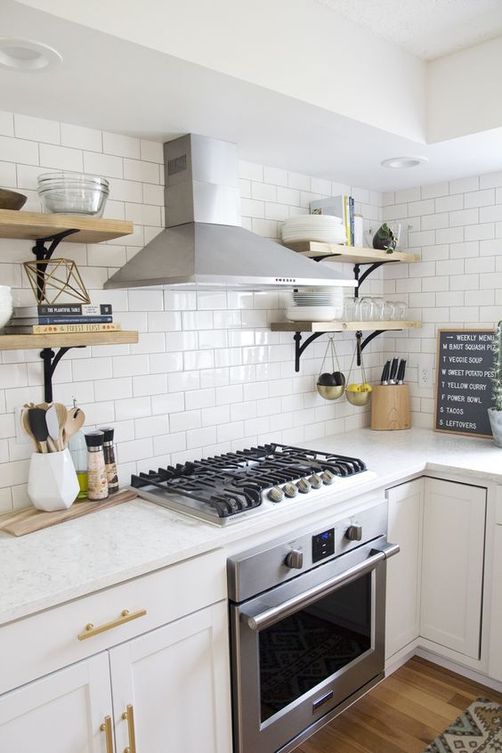 though satin stainless steel dominates here cause of appliances, brass adds a warm touch to the kitchen