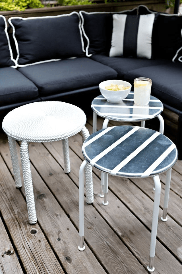 IKEA ROXO stools revamped with rope and metallic vent tape for a nautical feel in your backyard