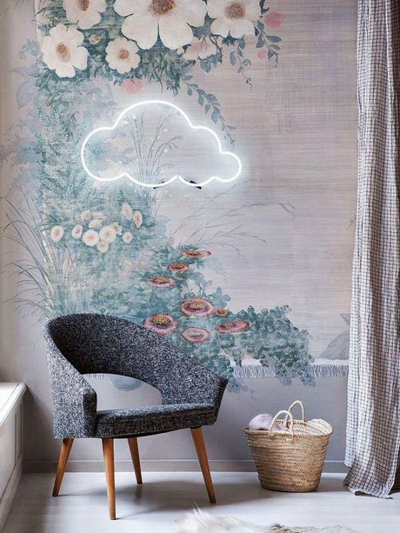 a cloud neon light over a chair in the reading nook creates a dreamy and welcoming ambience to enjoy