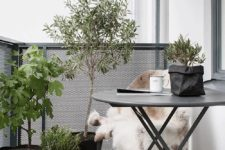 17 a dark metal folding furniture set, potted greenery and flowers, candle lanterns for a Scandinavian feel