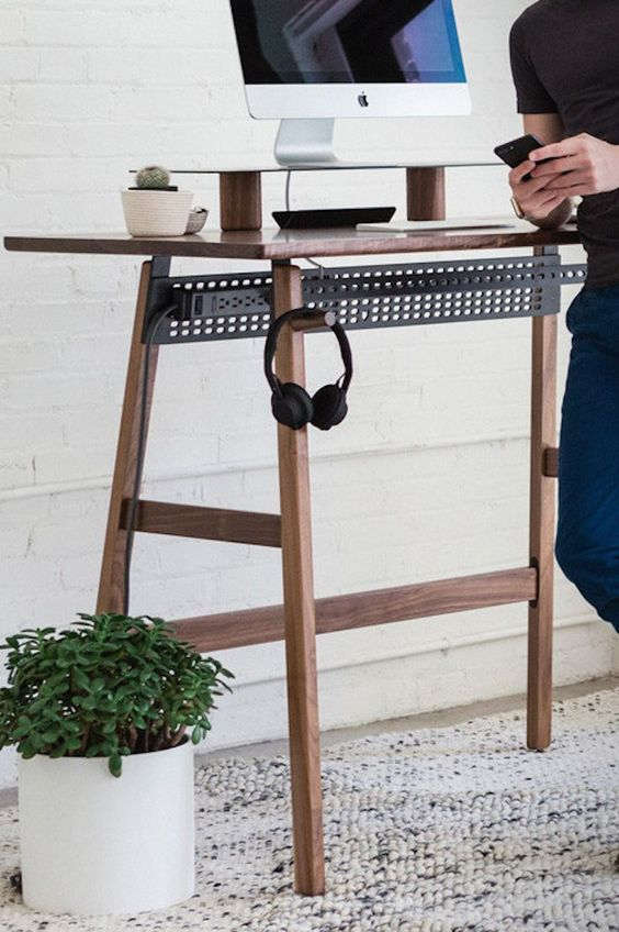 a stylish contemporary standing desk of wood and blackened steel won't spoil your space
