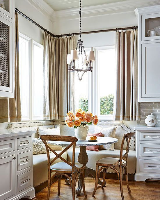 a traditional space with a vintage feel and a corner banquette seating with a nail trim