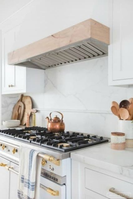 bright gold touches dominate over the space but you may also see some stainless steel and copper