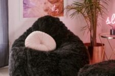 17 make your conversation space more glam with two fluffy bean bag chairs in black and pink pillows