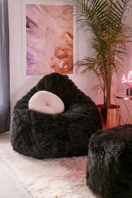 make your conversation space more glam with two fluffy bean bag chairs in black and pink pillows