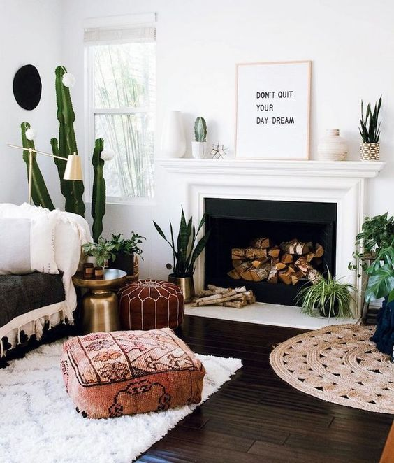 a Moroccan-styled and fabric printed ottoman help make this space more boho-like