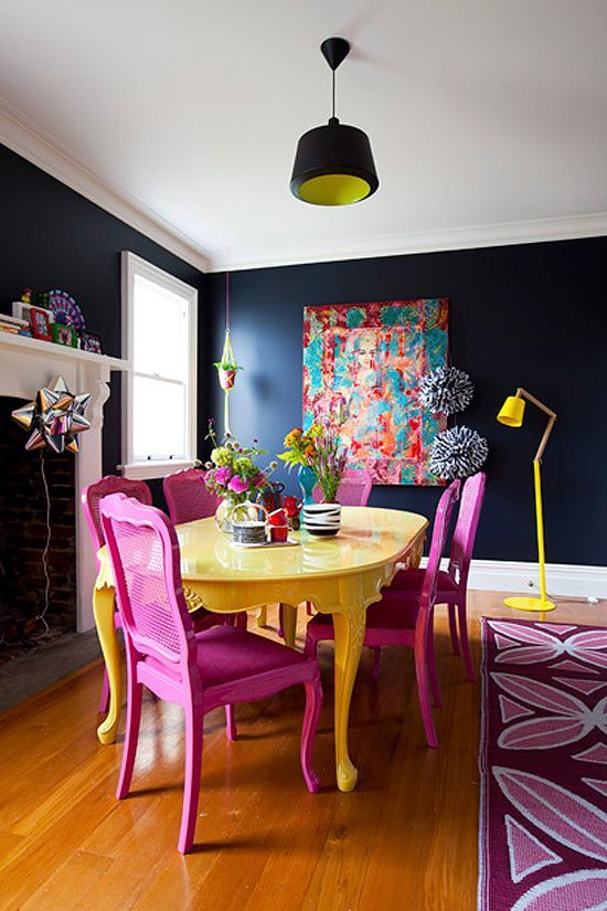 a dark space with several bright accents in magenta and bold yellow for a contrasting look