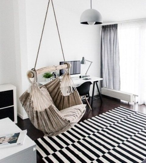 a hammock chair as a unique and outstanding touch for a monochromatic Scandinavian space