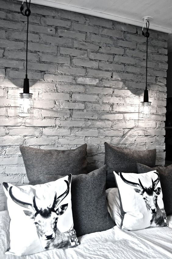 a monochromatic space with a grey brick wall that makes it more interesting
