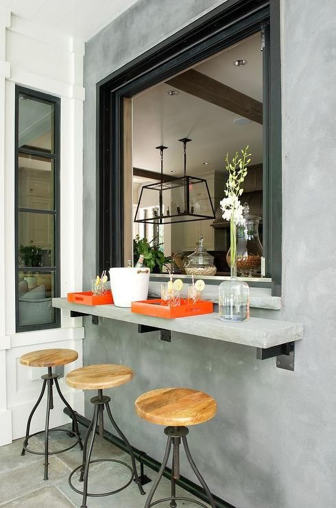 attach a concrete windowsill outdoors and use the kitchen window to serve drinks