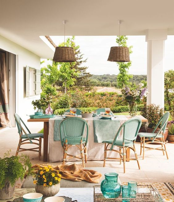 wicker turquoise chairs and wicker lampshades for a sweet rustic space with a Mediterranean feel